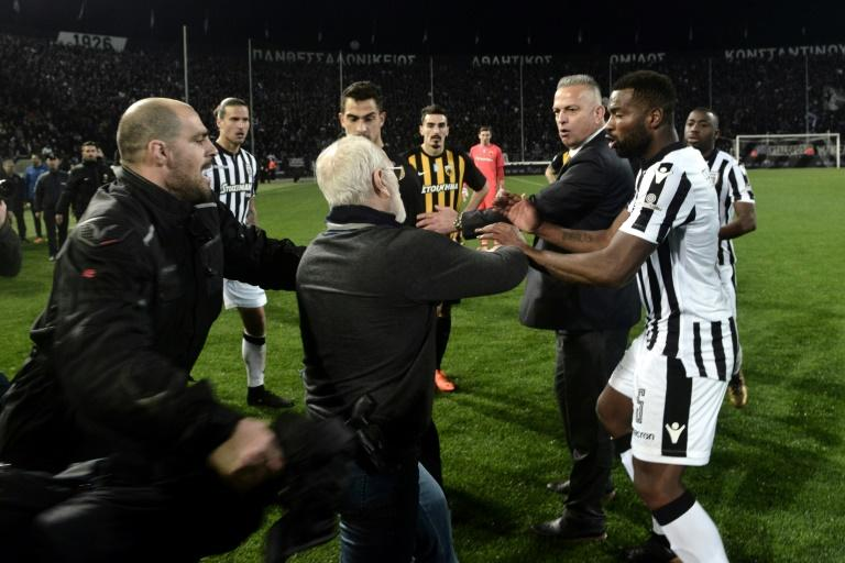 PAOK president Ivan Savvidis took to the field to remonstrate with a referee during a league game with AEK Athens in 2018 wearing a gun