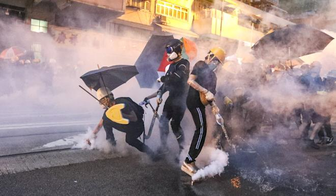 Riot police fire tear gas at anti-government protesters in the Western district of Hong Kong. Photo: Felix Wong