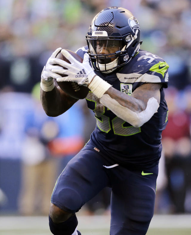 Seattle Seahawks' Chris Carson carries against the Arizona Cardinals during the first half of an NFL football game, Sunday, Dec. 30, 2018, in Seattle. (AP Photo/John Froschauer)
