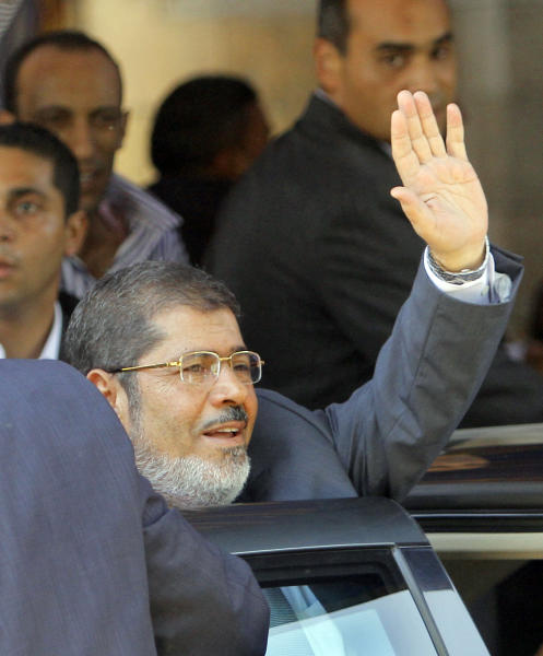 Egypt's President-elect Mohammed Morsi waves to his supporters following Friday prayers at Al-Azhar mosque, in Cairo, Egypt, Friday, June 29, 2012. Mohammed Morsi was declared Egypt's first freely elected president in modern history on Sunday, June 24, 2012. (AP Photo/Amr Nabil)
