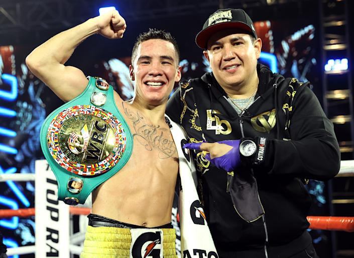LAS VEGAS, NV - FEBRUARY 20: Oscar Valdez and Trainer Eddy Reynoso after the victory over Miguel Berchelt for the WBC super featherweight title at the MGM Grand Conference Center on February 20, 2021 in Las Vegas, Nevada. (Photo by Mikey Williams/Top Rank Inc via Getty Images)