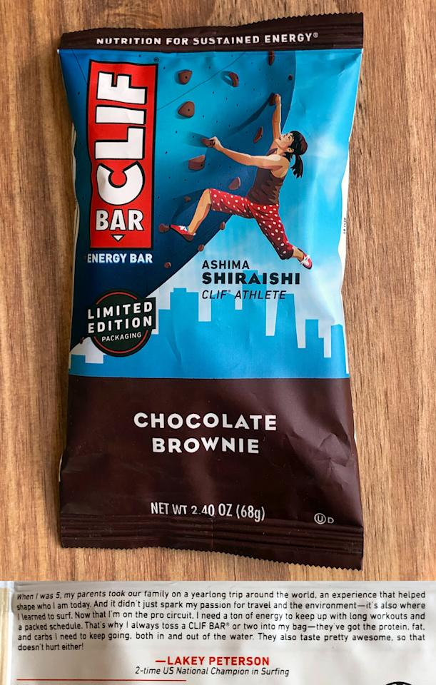"""<p>If you grab a Chocolate Brownie Clif Bar, you'll see 18-year-old <a href=""""https://www.popsugar.com/fitness/Who-Ashima-Shiraishi-46416798"""" class=""""ga-track"""" data-ga-category=""""Related"""" data-ga-label=""""https://www.popsugar.com/fitness/Who-Ashima-Shiraishi-46416798"""" data-ga-action=""""In-Line Links"""">Ashima Shiraishi</a>, 2017 US National Champion in sport and speed climbing. She started rock climbing at just 6 years old, and she was hooked (pun intended!). We've definitely got our eye on her for the <a href=""""https://www.popsugar.com/Summer-Olympics-2020"""" class=""""ga-track"""" data-ga-category=""""Related"""" data-ga-label=""""https://www.popsugar.com/Summer-Olympics-2020"""" data-ga-action=""""In-Line Links"""">2020 Summer Olympics</a>!</p>"""