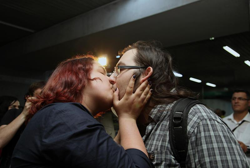 "A young Turkish couple kiss to protest against subway official's harassment of a couple for kissing in public last week, inside a subway stop in Ankara, Turkey, Saturday, May 25, 2013. Last week, Ankara subway officials made a reproaching announcement asking passengers ""to act in accordance with moral rules,"" after spotting the couple kissing through security cameras.(AP Photo/Burhan Ozbilici)"