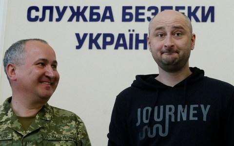 <span>Arkady Babchenko, right, appeared at a Press conference into his own 'death' held by the head of Ukraine's Security Service</span> <span>Credit: VALENTYN OGIRENKO /Reuters </span>