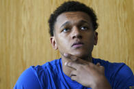 Duke forward Paolo Banchero takes questions during the team's NCAA college basketball media day in Durham, N.C., Tuesday, Sept. 28, 2021. (AP Photo/Gerry Broome)