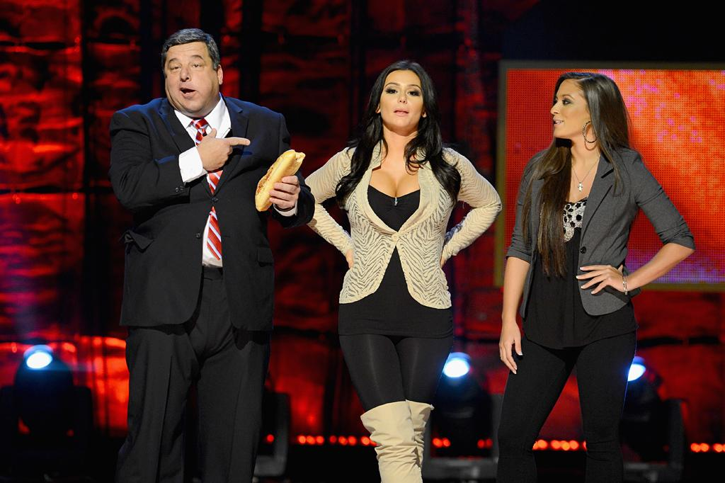 """NEW YORK, NY - OCTOBER 13:  (L-R) Steve Schirripa, Jenni """"J Woww"""" Farley and Sammi """"Sweetheart"""" Giancola speak onstage at Comedy Central's night of too many stars: America comes together for autism programs at The Beacon Theatre on October 13, 2012 in New York City.  (Photo by Dimitrios Kambouris/Getty Images)"""