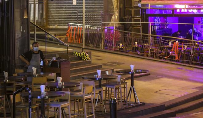 A normally busy Lan Kwai Fong eatery lies empty on March 22. Photo: Dickson Lee