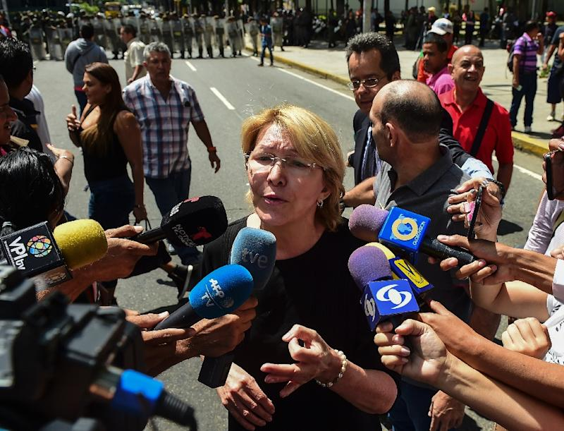 Venezuela's attorney general Luisa Ortega, one of President Nicolas Maduro's most vocal critics, speaks to the press during a flash visit to the Public Prosecutor's office in Caracas, on August 5, 2017
