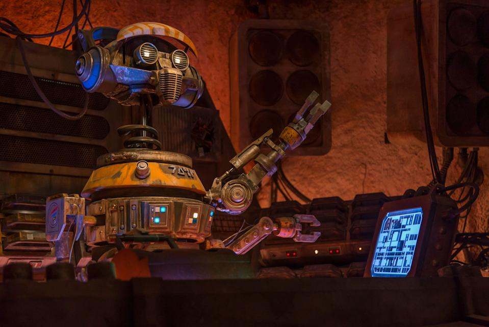 """This former Star Tours pilot droid, known as """"Rex,"""" crash landed on Batuu and was reprogrammed. """"DJ Rex"""" now provides the musical entertainment inside Oga's Cantina (Joshua Sudock/Disney Parks)"""