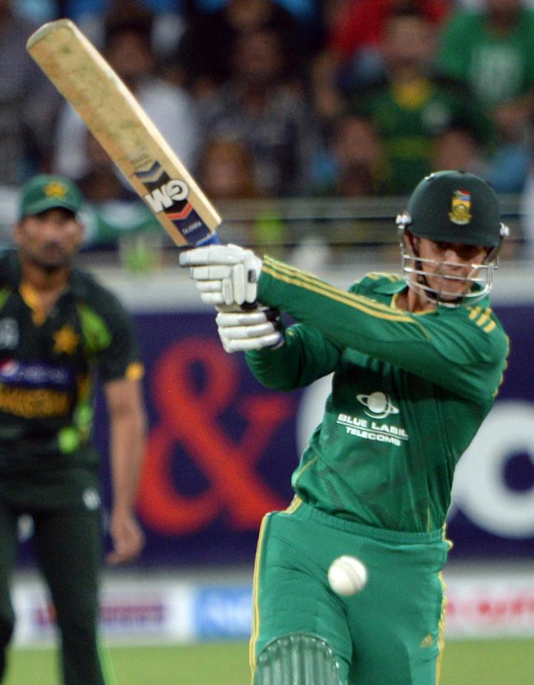 South African opener batsman Quinton de Kock plays a shot during the First T20 International at Dubai stadium on November 13, 2013. Pakistan captain Mohammad Hafeez won the toss and elected to bat in the first Twenty20 international against South Africa in Dubai . AFP PHOTO/ Asif HASSAN        (Photo credit should read ASIF HASSAN/AFP/Getty Images)