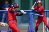 United States' Janie Reed bats during the softball game between Italy and the United States at the 2020 Summer Olympics, Wednesday, July 21, 2021, in Fukushima , Japan. (AP Photo/Jae C. Hong)