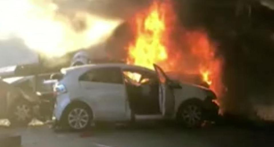 A 30-year-old truck driver has been charged over a fiery crash in Sydney's north, which led to the deaths of two people at Mooney Mooney Creek on Tuesday. Source: 7 News