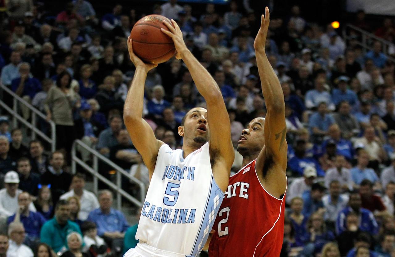 ATLANTA, GA - MARCH 10:  Kendall Marshall #5 of the North Carolina Tar Heels drives for a shot attempt against Lorenzo Brown #2 of the North Carolina State Wolfpack during their Semifinal game of the 2012 ACC Men's Basketball Conferene Tournament at Philips Arena on March 10, 2012 in Atlanta, Georgia.  (Photo by Streeter Lecka/Getty Images)