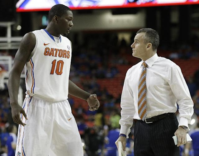Florida head coach Billy Donovan speaks to Dorian Finney-Smith (10) during the second half of an NCAA college basketball game against Kentucky in the Championship round of the Southeastern Conference men's tournament, Sunday, March 16, 2014, in Atlanta. (AP Photo/Steve Helber)