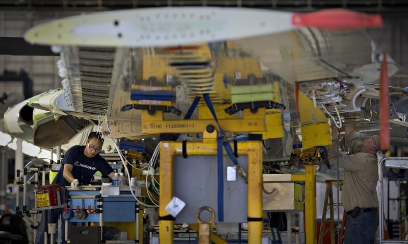 Workers assemble a wing for the Boeing 737-900 at their operations in Renton