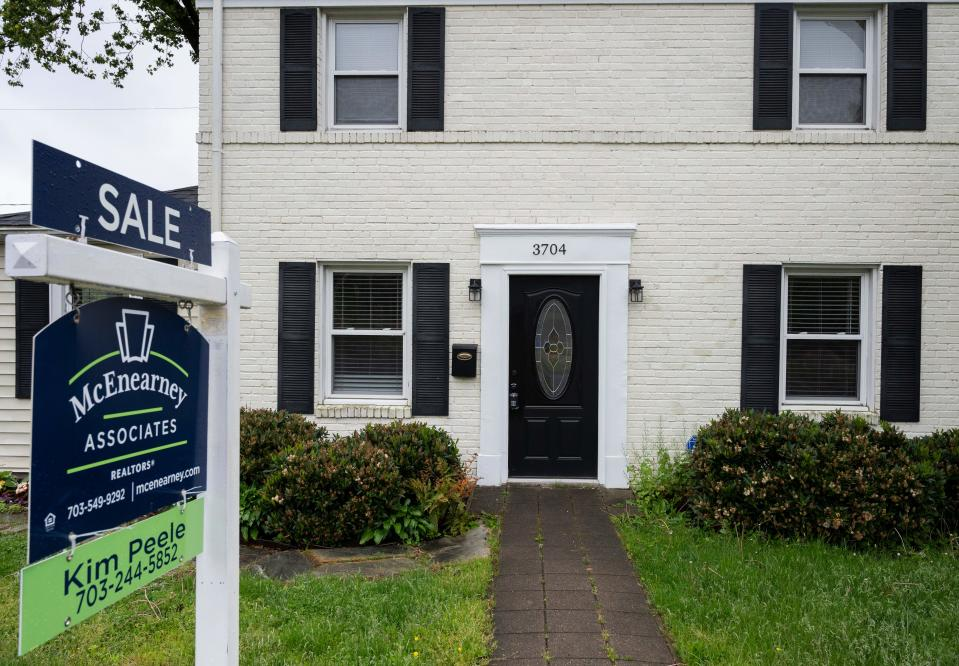 A for sale sign is seen next to a house in Arlington, Virginia on May 6, 2020. (Photo by ANDREW CABALLERO-REYNOLDS/AFP via Getty Images)