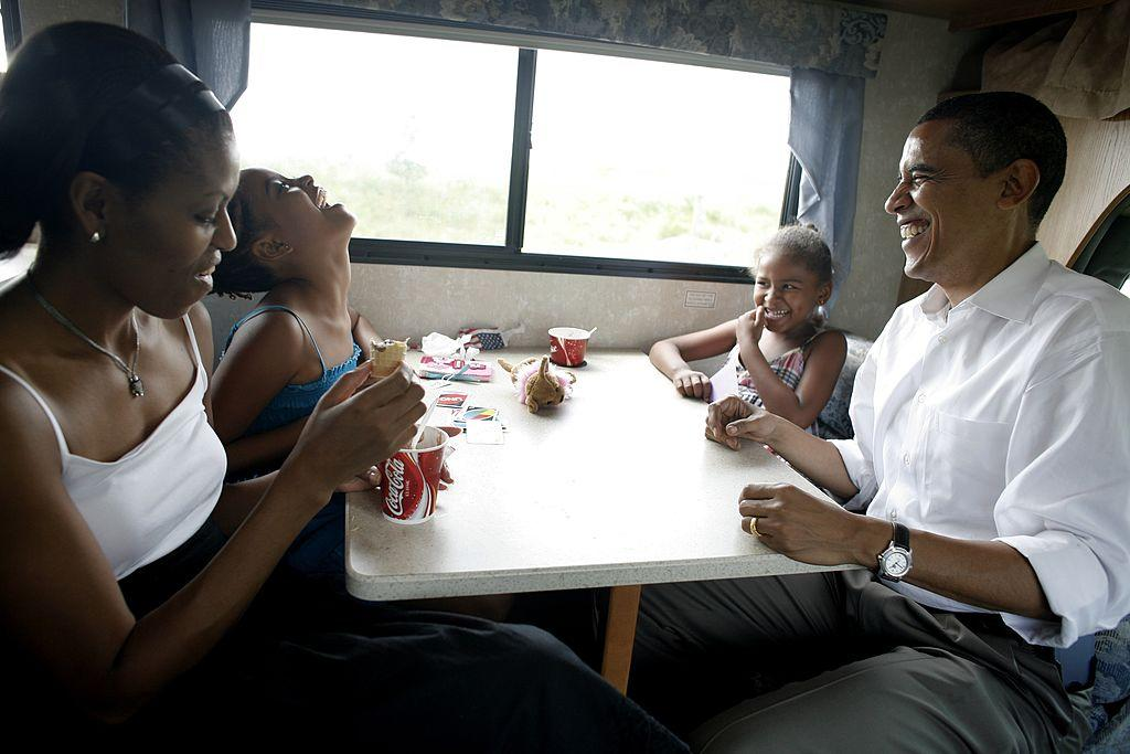 <p>Playing cards in their RV on a campaign swing between Oskaloosa and Pella, Iowa [Photo: Charles Ommanney/Getty] </p>