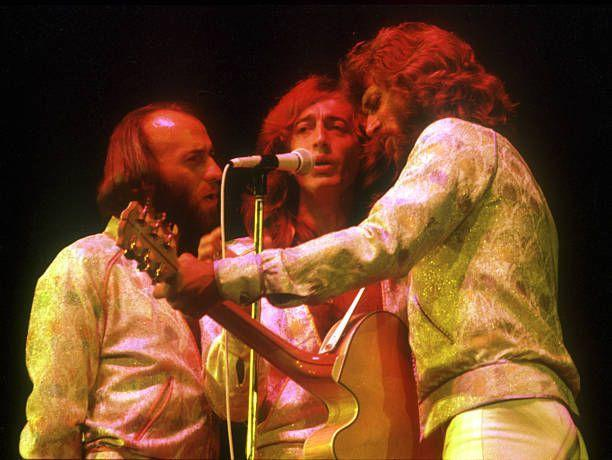 """<p>With so many recent hits, the Bee Gees were the natural choice to score the soundtrack for <u></u>""""Saturday Night Fever"""" (1977). The record earned a Grammy for album of the year and would eventually sell 40 million copies, becoming the best-selling soundtrack in history until Michael Jackson's <u>Thriller</u>. The <a href=""""https://www.amazon.com/Saturday-Night-Fever-2-LP/dp/B01N5M0897/?tag=syn-yahoo-20&ascsubtag=%5Bartid%7C10055.g.33861456%5Bsrc%7Cyahoo-us"""" rel=""""nofollow noopener"""" target=""""_blank"""" data-ylk=""""slk:album's"""" class=""""link rapid-noclick-resp"""">album's </a>three #1 hits included """"How Deep is Your Love,"""" """"Stayin' Alive,"""" and """"Night Fever.""""</p>"""