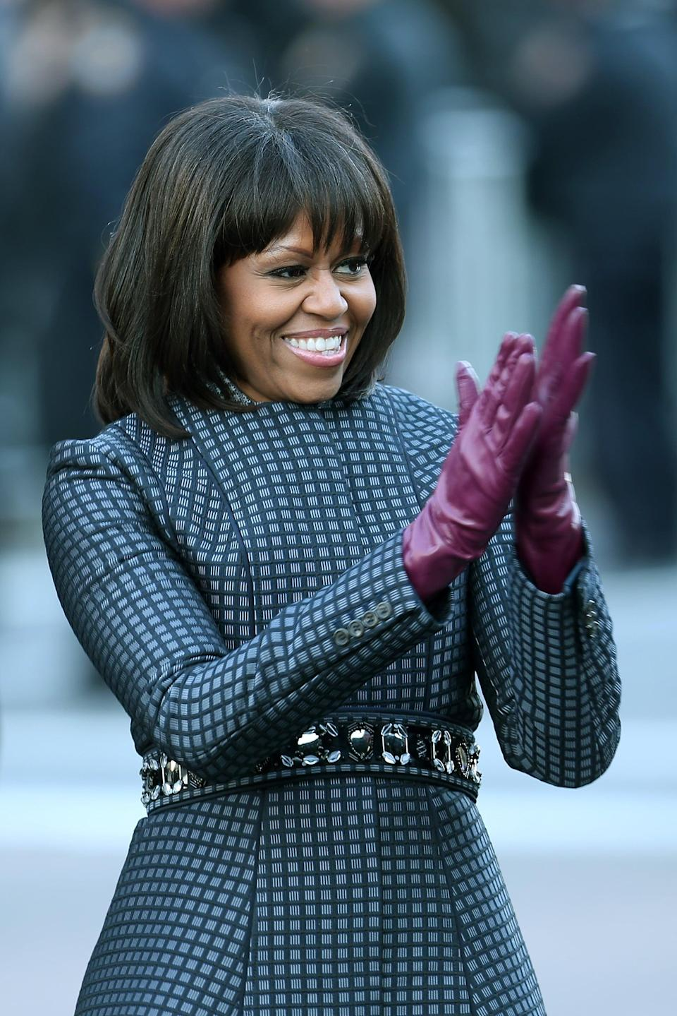 WASHINGTON, DC - JANUARY 21:  First lady Michelle Obama walks the route as the presidential inaugural parade winds through the nation's capital January 21, 2013 in Washington, DC. Barack Obama was re-elected for a second term as President of the United States.  (Photo by Chip Somodevilla/Getty Images)