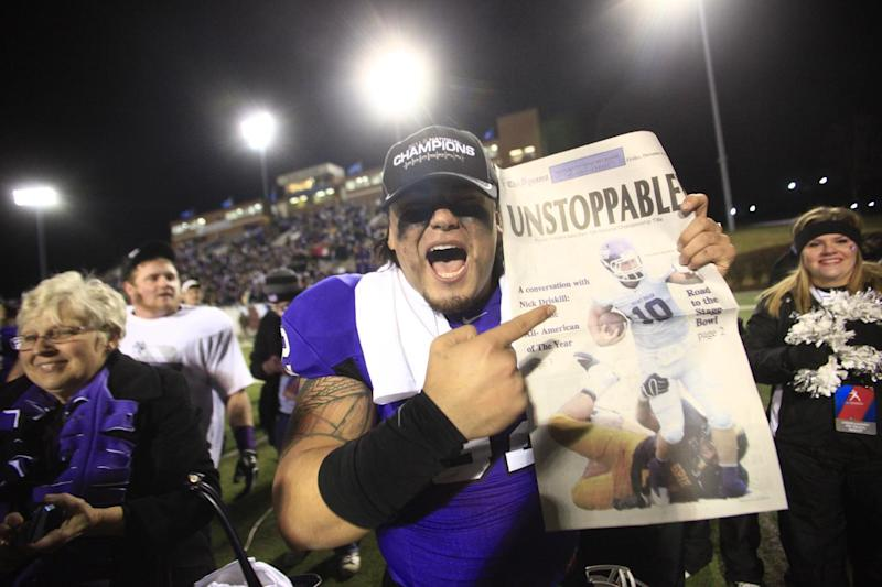 Mount Union's Charlie Avila (92) celebrates after the conclusion of the NCAA Division III football championship between Mount Union and St. Thomas in Salem, Va., Friday, Dec. 14, 2012. Mount Union won 28-10. (AP Photo/The Roanoke Times, Daniel Lin) LOCAL TV OUT; LOCAL INTERNET OUT; LOCAL PRINT OUT (SALEM TIMES REGISTER; FINCASTLE HERALD; CHRISTIANSBURG NEWS MESSENGER; RADFORD NEWS JOURNAL; ROANOKE STAR SENTINEL)