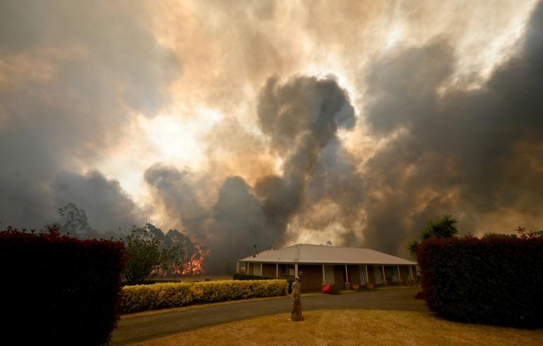 Australia's bushfire season came early and hit with unrecedented intensity this year, which scientists attribute in part to global warming (AFP Photo/PETER PARKS)