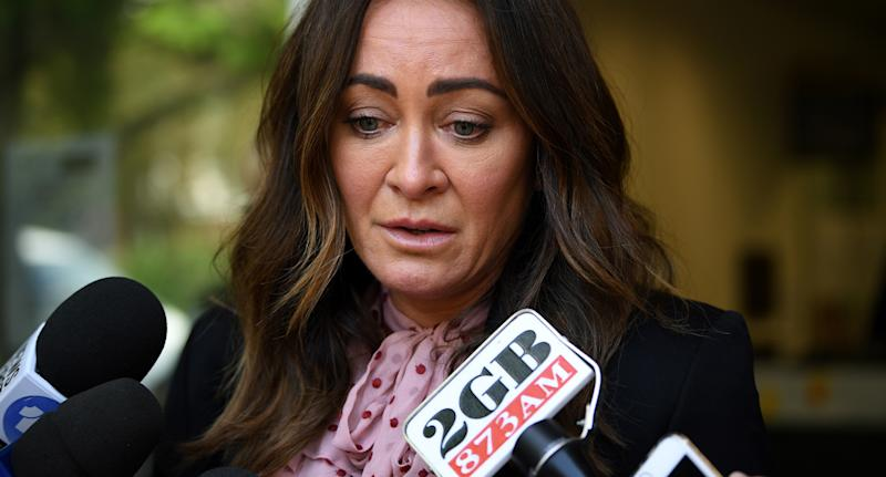 Michelle Bridges cries as she speaks to reporters outside court on Tuesday.