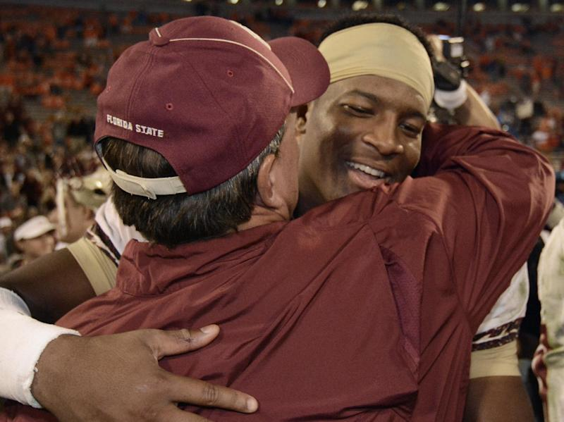 Florida State quarterback Jameis Winston, right, embraces Florida State head coach Jimbo Fisher after the second half of an NCAA college football game against Clemson, Sunday, Oct. 20, 2013, in Clemson, S.C. Florida State won 51-14. (AP Photo/Richard Shiro)
