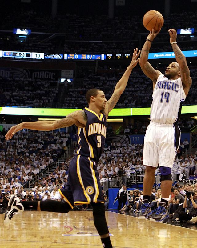 ORLANDO, FL - MAY 02: Guard Jameer Nelson #14 of the Orlando Magic shoots against Guard George Hill #3 of the Indiana Pacers in Game Three of the Eastern Conference Quarterfinals in the 2012 NBA Playoffs at Amway Center on May 2, 2012 in Orlando, Florida. NOTE TO USER: User expressly acknowledges and agrees that, by downloading and or using this photograph, User is consenting to the terms and conditions of the Getty Images License Agreement. (Photo by Marc Serota/Getty Images)