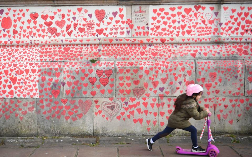 More than one thousand people, including the bereaved, NHS staff, volunteers and members of the public have painted 150,000 hearts on the wall - Victoria Jones/PA Wire