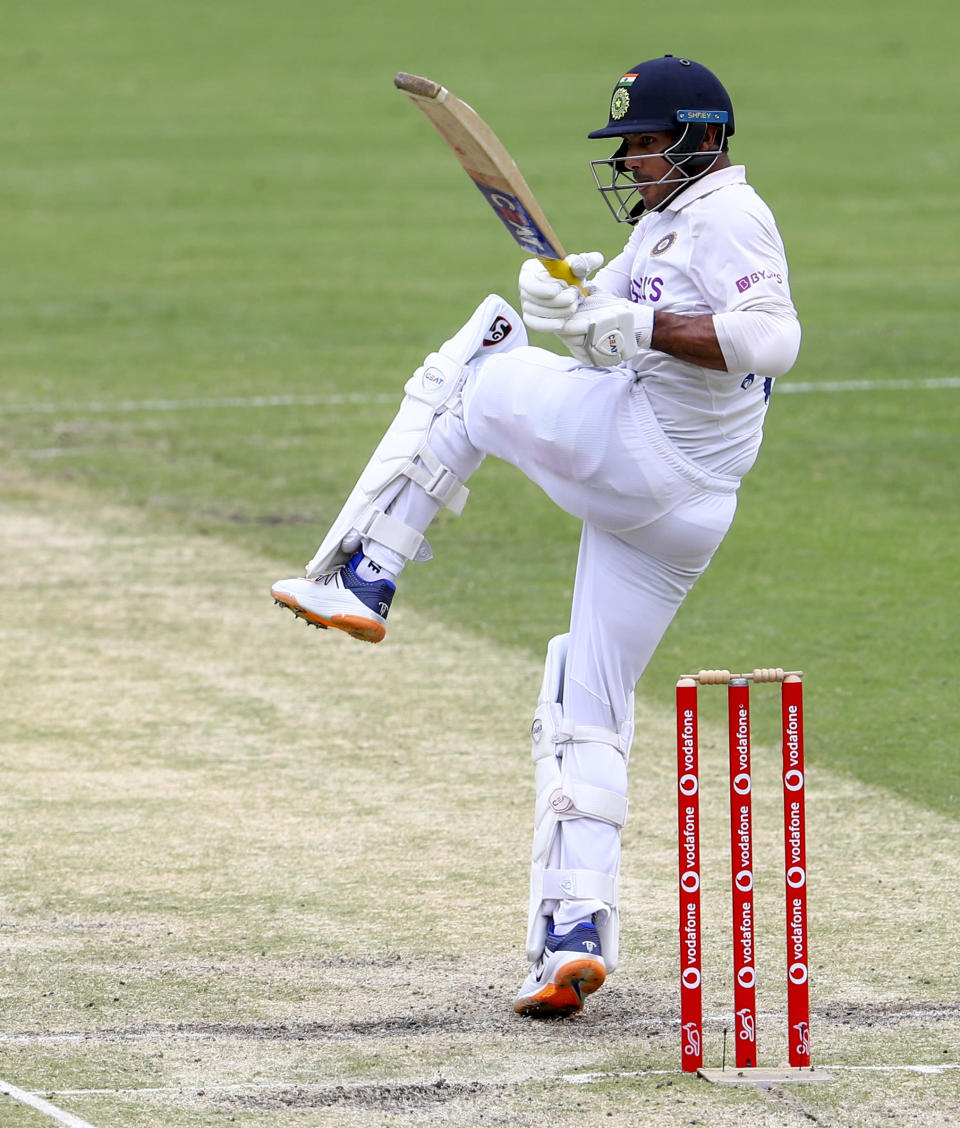 India's Mayank Agarwal bats during play on day three of the fourth cricket test between India and Australia at the Gabba, Brisbane, Australia, Sunday, Jan. 17, 2021. (AP Photo/Tertius Pickard)