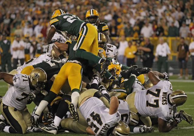 GREEN BAY, WI - SEPTEMBER 08: Members of the Green Bay Packer defense stop the New Orleans Saints short of the goal on the final play of the game during the NFL opening season game at Lambeau Field on September 8, 2011 in Green Bay, Wisconsin. The Packers defeated the Saints 42-34. (Photo by Jonathan Daniel/Getty Images)