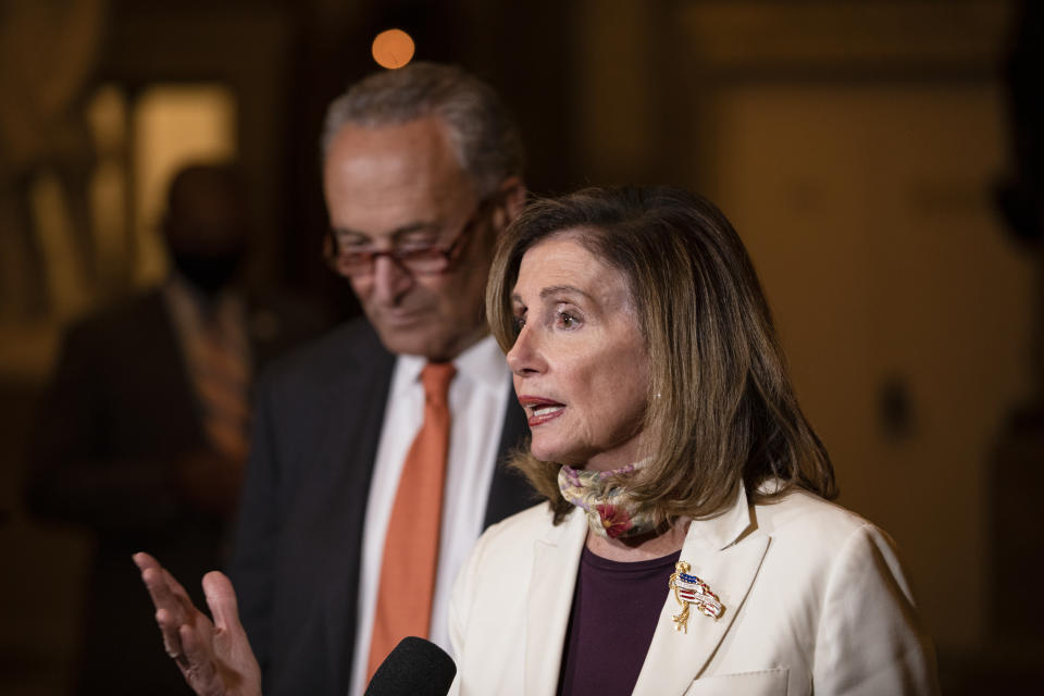 U.S. House Speaker Nancy Pelosi speaks to reporters alongside Senate Minority Leader Chuck Schumer following continued negotiations with Treasury Secretary Steven Mnuchin and White House Chief of Staff Mark Meadows. (Photo by Samuel Corum/Getty Images)
