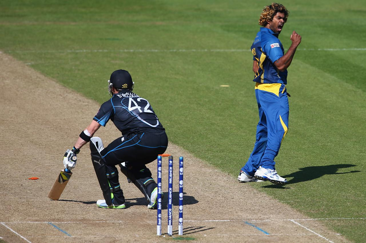 CARDIFF, WALES - JUNE 09:  Lasith Malinga (R) of Sri Lanka celebrates bowling Brendon McCullum (L) of New Zealand during the Group A ICC Champions Trophy match between Sri Lanka and New Zealand at the SWALEC Stadium on June 9, 2013 in Cardiff, Wales.  (Photo by Michael Steele/Getty Images)