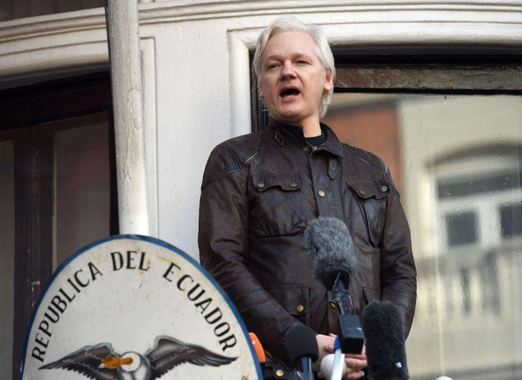 Julian Assange speaks from the balcony of the Ecuadorian embassy in London after a seven-year investigation in Sweden against the WikiLeaks founder was suddenly dropped.(PA)