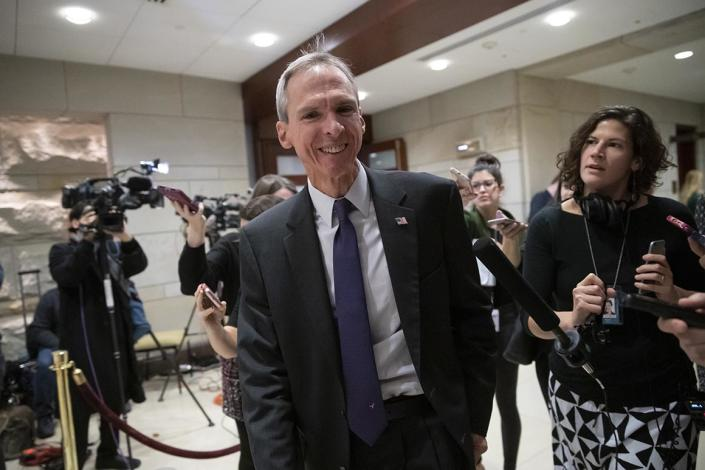 Rep. Dan Lipinski, D-Ill., is met by reporters as he leaves the Democratic Caucus leadership elections at the Capitol in Washington, Wednesday, Nov. 28, 2018. Lipinski is part of the nine-member Problem Solvers Caucus negotiating with House Democratic Leader Nancy Pelosi over rules changes. (AP Photo/J. Scott Applewhite)