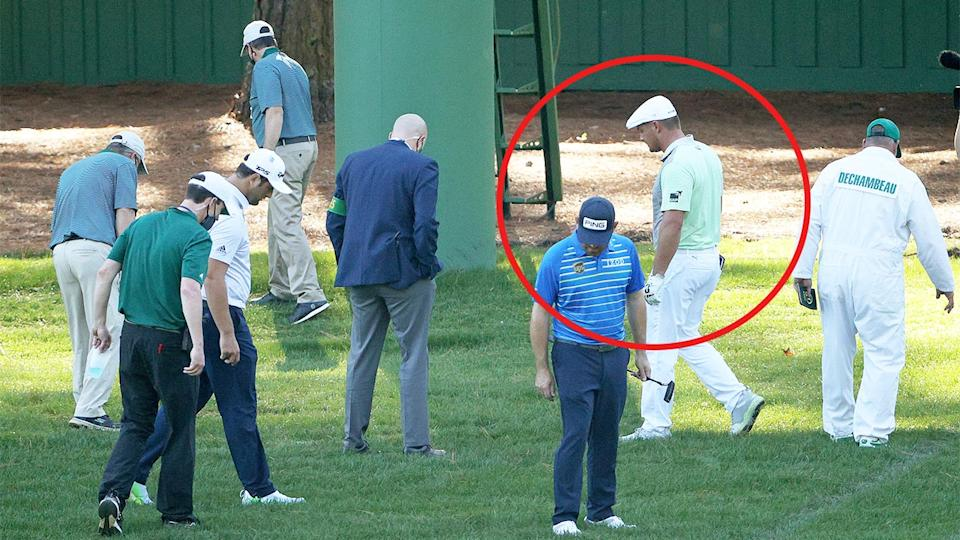 Bryson DeChambeau (pictured in the circle) walking around and looking for his golf ball with officials at The Masters.