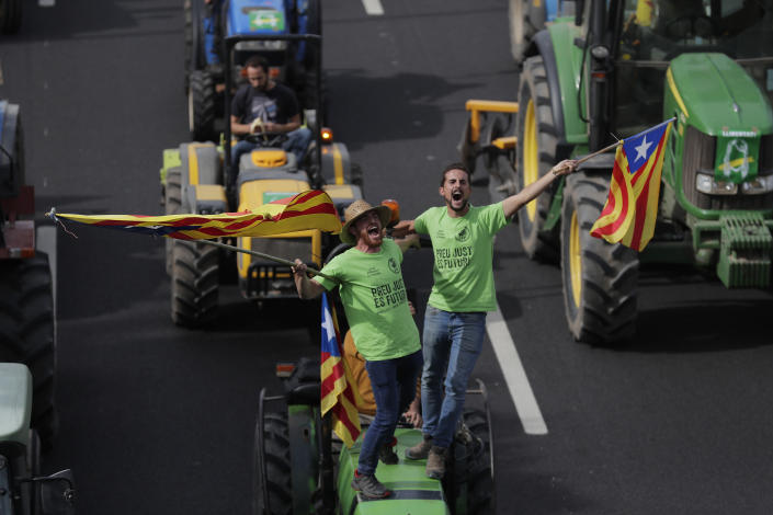 Protesters ride on tractors as they enter the city on the fifth day of protests over the conviction of a dozen Catalan independence leaders in Barcelona, Spain, Friday, Oct. 18, 2019. (Photo: Manu Fernandez/AP)