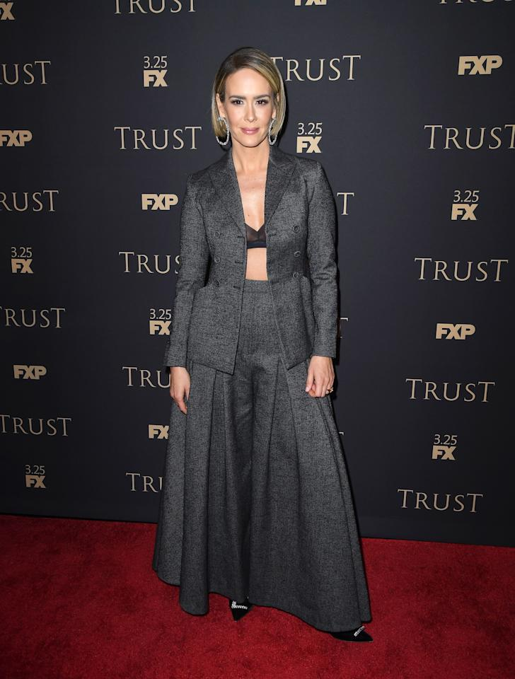 <p>The 'American Horror Story' star teamed a longline grey skirt with a matching blazer and a sheer bra at the annual star-studded bash. <em>[Photo: Getty]</em> </p>