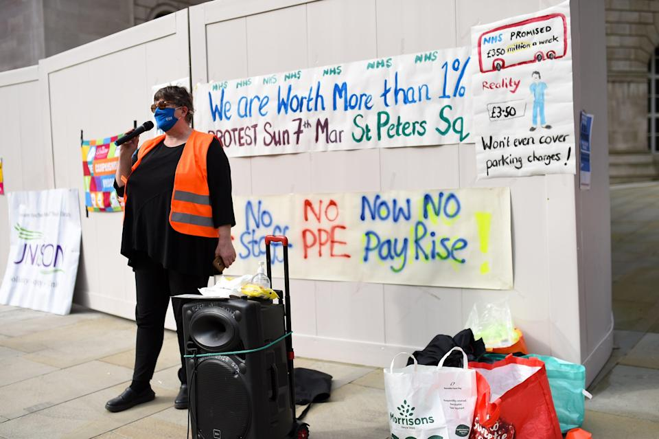 People protesting in St Peter's Square in Manchester, over the proposed 1% pay rise for NHS workers from the Government (Jacob King/PA) (PA Wire)