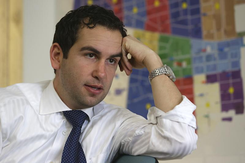 In this Friday, March 15, 2013 photo, Steven Fulop talks to The Associated Press at his campaign headquarters in Jersey City, N.J. Fulop is challenging incumbent Jerramiah Healy, for mayor of Jersey City. The campaign between 62-year-old Healy and 36-year-old Fulop personifies the gentrification playing out in cities across the country, from California's Bay Area to New York City, as young, mostly white professionals priced out of certain areas build new lives _ and in some places a new political culture _ amid swaths of the old guard. (AP Photo/Julio Cortez)