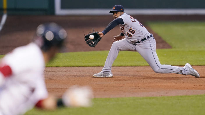 Detroit Tigers third baseman Jeimer Candelario (46) fields a grounder by Boston Red Sox designated hitter J.D. Martinez during the first inning of a baseball game at Fenway Park, Tuesday, May 4, 2021, in Boston. (AP Photo/Charles Krupa)