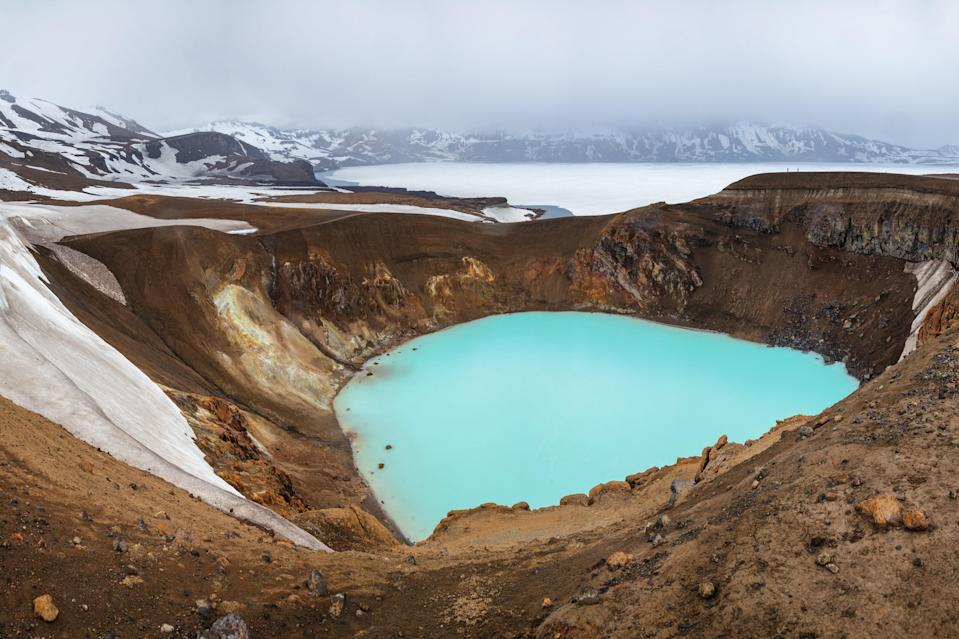 """Scientists have confirmed Víti naturally formed at the bottom of one of Askja's craters. But its name, meaning """"hell,"""" owes to lore that Iceland's <a href=""""http://www.cntraveler.com/galleries/2014-12-03/the-most-intense-volcanic-craters-in-the-world?mbid=synd_yahoo_rss"""" rel=""""nofollow noopener"""" target=""""_blank"""" data-ylk=""""slk:large craters"""" class=""""link rapid-noclick-resp"""">large craters</a> were gates to the underworld. And it's not just eye candy: Weather permitting, visitors can swim in the warm, mineral-rich lake."""
