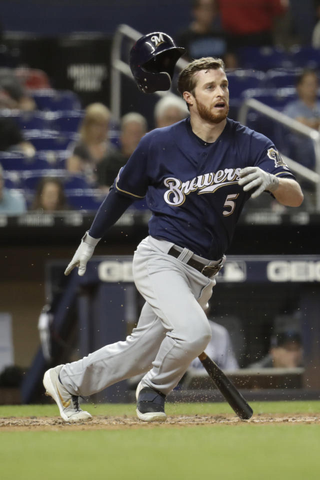 Milwaukee Brewers' Cory Spangenberg (5) loses his helmet as he grounds out to first during the fourth inning of a baseball game against the Miami Marlins, Wednesday, Sept. 11, 2019, in Miami. (AP Photo/Lynne Sladky)