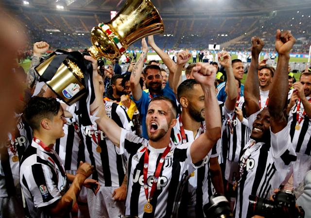 Soccer Football - Coppa Italia Final - Juventus vs AC Milan - Stadio Olimpico, Rome, Italy - May 9, 2018 Juventus' Miralem Pjanic celebrates with the trophy after winning the Coppa Italia REUTERS/Stefano Rellandini