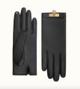 """<p><strong>Hermes</strong></p><p>hermes.com</p><p><strong>$860.00</strong></p><p><a href=""""https://www.hermes.com/us/en/product/soya-gloves-H005060GT01060/"""" rel=""""nofollow noopener"""" target=""""_blank"""" data-ylk=""""slk:Shop Now"""" class=""""link rapid-noclick-resp"""">Shop Now</a></p><p>How about a pair to match your <a href=""""https://www.townandcountrymag.com/style/fashion-trends/a30912988/handbag-trends-coronavirus-2021/"""" rel=""""nofollow noopener"""" target=""""_blank"""" data-ylk=""""slk:Kelly bag"""" class=""""link rapid-noclick-resp"""">Kelly bag</a>? </p>"""