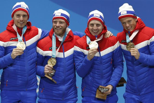Medals Ceremony - Cross-Country Skiing - Pyeongchang 2018 Winter Olympics - Men's 4x10 km Relay - Medals Plaza - Pyeongchang, South Korea - February 18, 2018 - Gold medalists Didirk Toenseth, Johnsrud Martin Sundby, Simen Hegstad Kreuger and Johannes Hoesflot Klaebo of Norway on the podium. REUTERS/Eric Gaillard