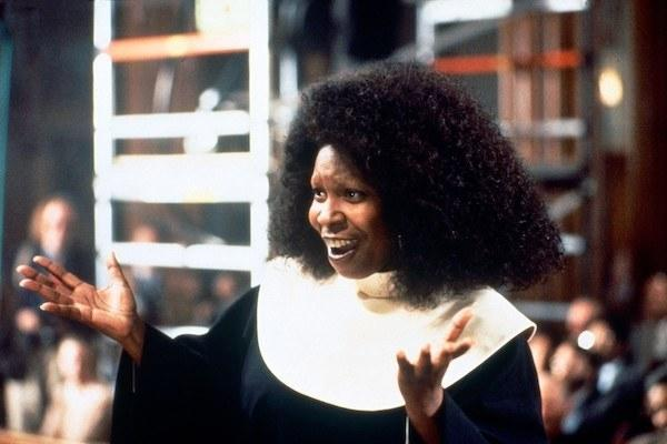 Whoopi Goldberg singing her heart out.