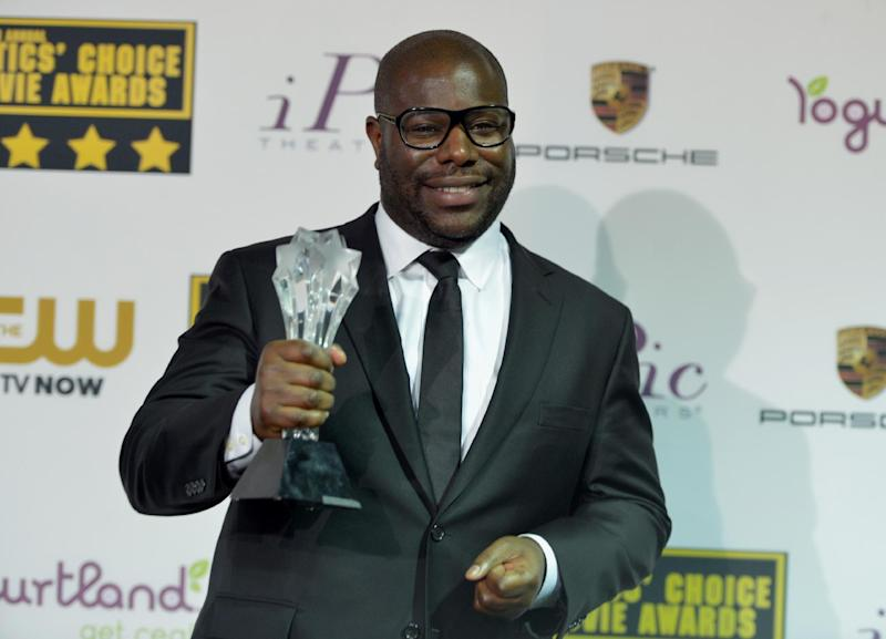 """Steve McQueen poses in the press room with the award for best picture for """"12 Years a Slave"""" at the 19th annual Critics' Choice Movie Awards at the Barker Hangar on Thursday, Jan. 16, 2014, in Santa Monica, Calif. (Photo by John Shearer/Invision/AP)"""