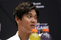 Shohei Ohtani, of the Los Angeles Angeles, speaks after being named the American League's starting pitcher for the MLB All-Star baseball game, Monday, July 12, 2021, in Denver. (AP Photo/David Zalubowski)