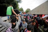 Honduran migrants board trucks sending them back to Honduras, after they crossed the border into Guatemala illegally in their bid to reach the U.S., in Agua Caliente, Guatemala October 17, 2018. REUTERS/Jorge Cabrera